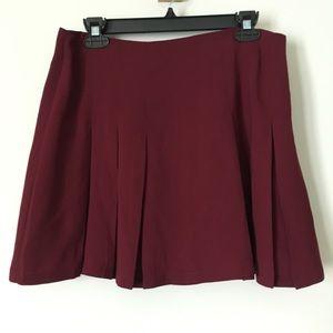 Pleated red skater skirt